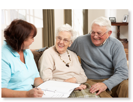 elderly couple receiving information from coordinator