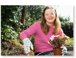 young woman with Down syndrome gardening